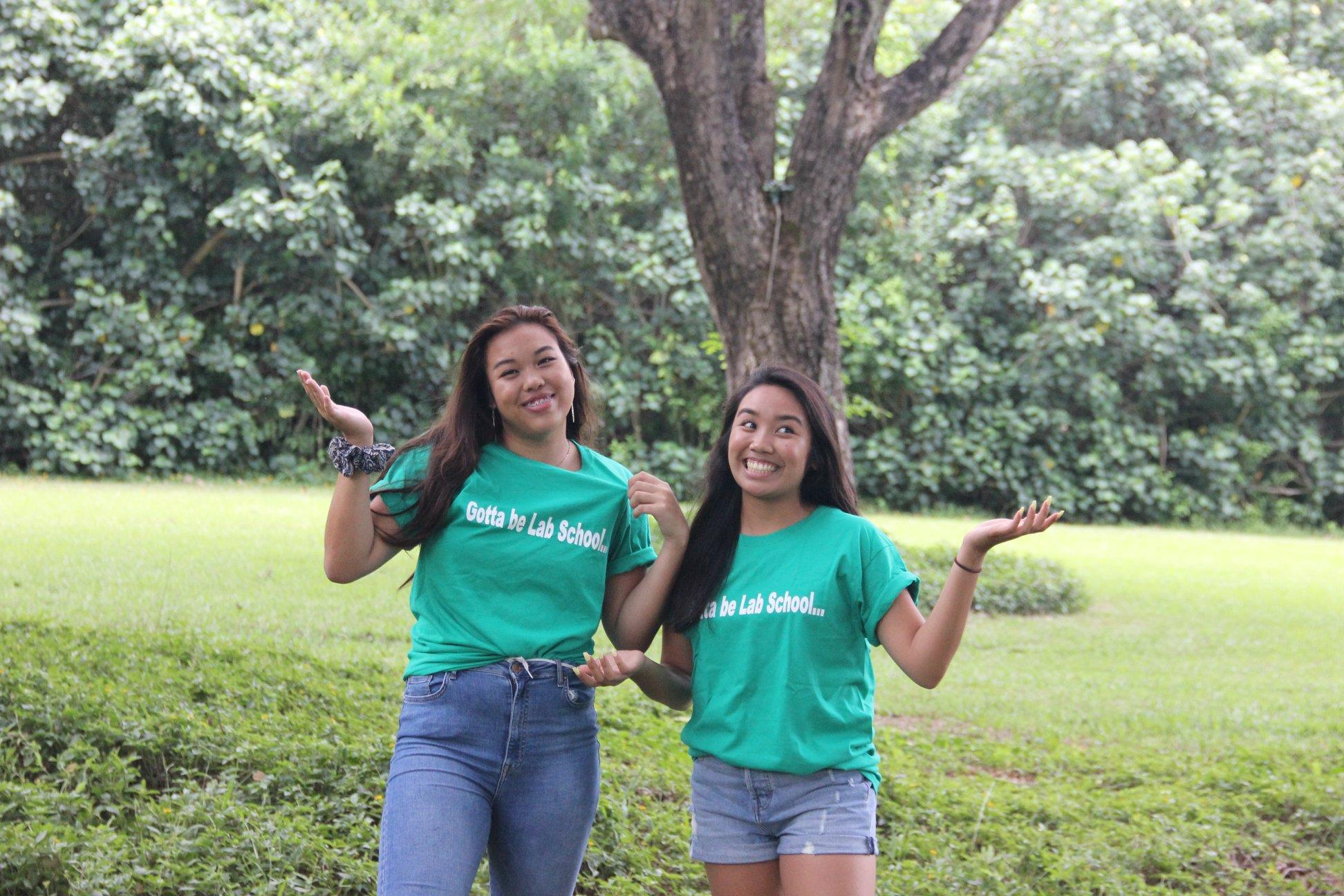 Photos of 2019 graduates Shania Lei Gabrillo and Brianna Tancinco wearing their Gotta be Lab School shirts courtesy of Jared Fuchigami '95.