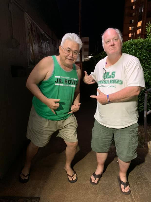 Bill Teter and Lanning Lee wearing Lab School related T-shirts.
