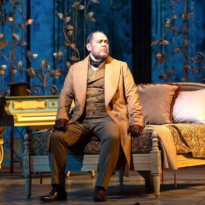 Hawaiian baritone Quinn Kelsey, who has emerged as one of the greatest contemporary American (and international) Verdi baritones performing the role of the Elder Germont in the new production of Verdi's La Traviata at the New York Metropolitan Opera. Photo: Quinn Kelsey as Giorgio Germont; edited image, based on a Marty Sohl photograph for the New York Metropolitan Opera.