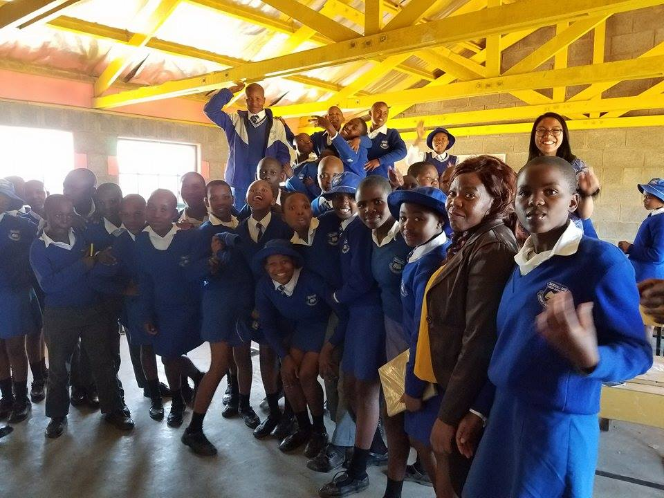 Kelly with her students in the country of Lesotho.