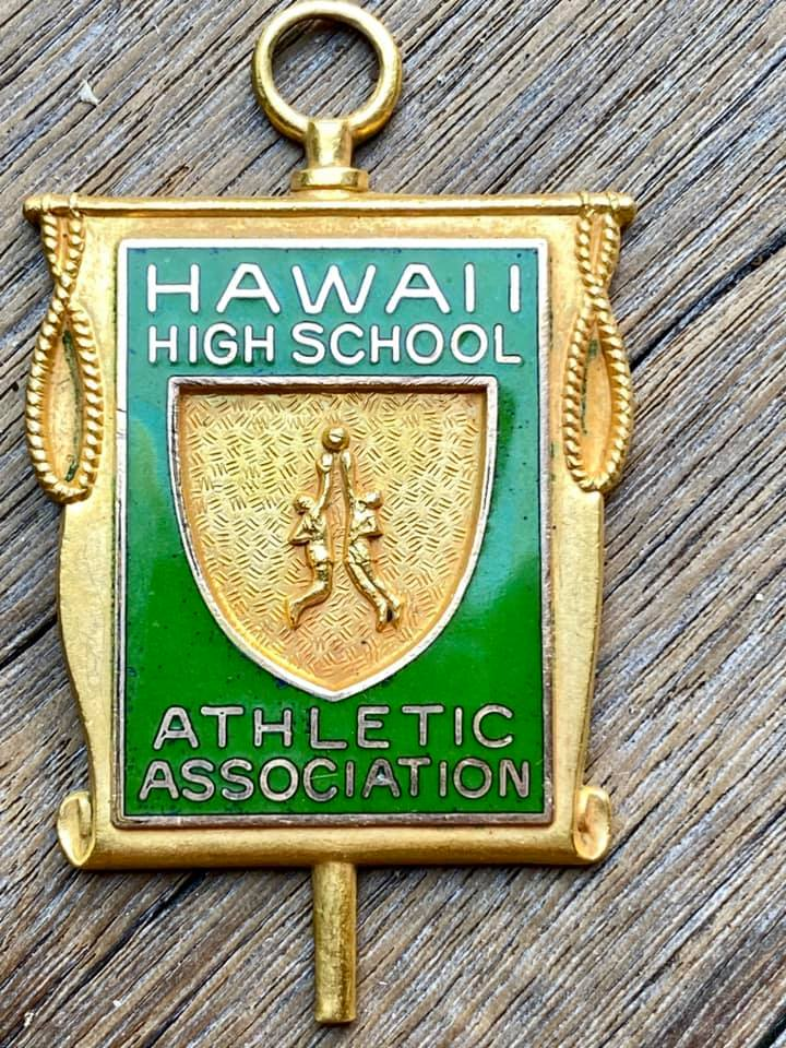 an old Hawaii High School Athletic Association pin