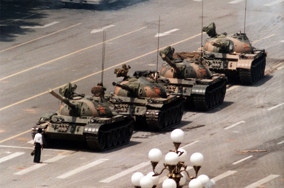 Weilin Wang facing down Chinese military tanks during the Tiananmen Square protests.